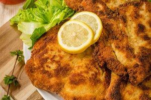 Delicious schnitzel with salad