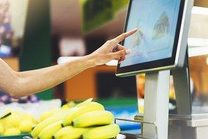 Weighing bananas in the supermarket