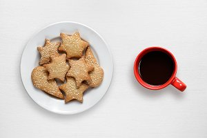 Coffee cup and cookies in plate