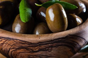 Olives in olive wooden bowl