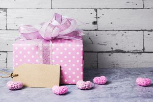 Pink gift box and heart