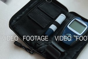 Preparing for blood sugar test with home glucometer