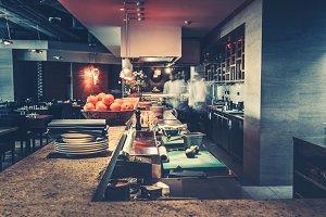 Modern kitchen and chefs in restaurant