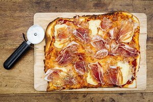 Traditional ham and brie cheese pizza