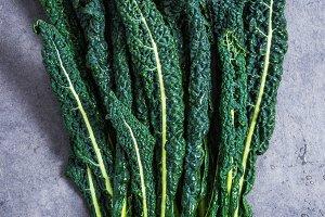 Kale leaves on dark stone background