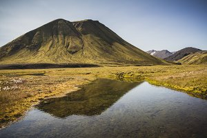 Green volcanic mountain. Iceland