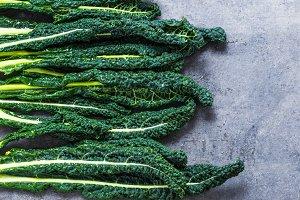 Kale leaves on dark background.