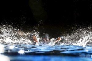 Swimmer triathlon in the water swimming
