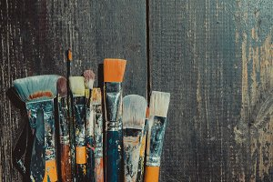 Artistic brushes on table