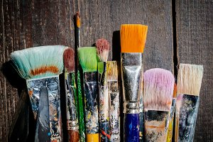 Brushes on wooden background #3