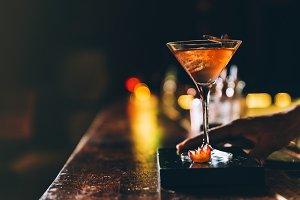 Cocktail drink on night club.