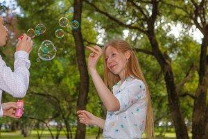 Female touching bubble