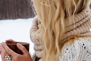 Girl drinks hot tea in winter