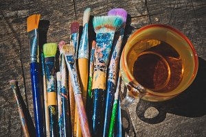 Paintbrushes and a cup of tea
