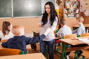 Teacher helps the pupil