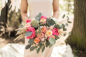 Bride in with beautiful bouquet