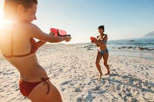 Young women playing water gun