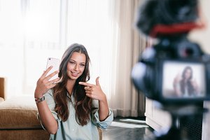 Young woman recording her video