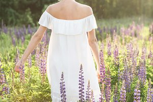 woman in white dress in flower field