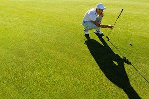 Golfer checking line