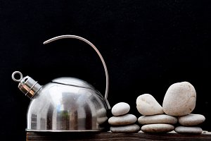 Kettle and white stones