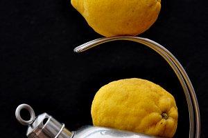 Kettle and yellow lemons