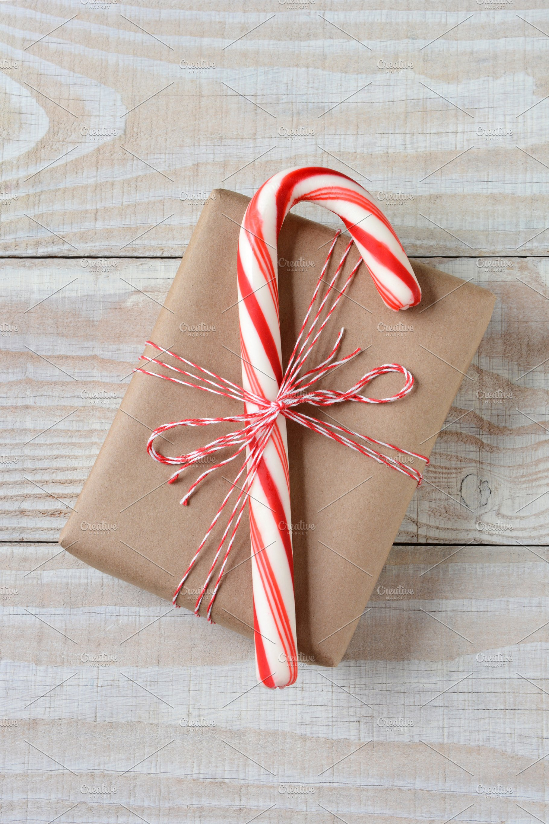 Christmas gift wrap: candy cane tied onto gift box