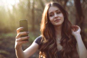 Girl making selfie photo