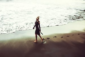 Girl is walking along the beach