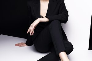 Fashion woman in black suit