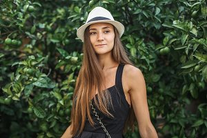 girl in hat in garden