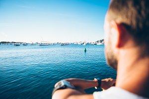 Man looking at boats