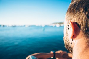 Man listening to music at sea