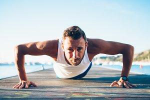 Healthy fit man exercising push ups