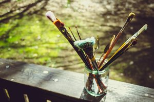 Paint brushes in a glass jar