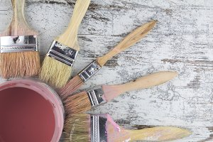 Paintbrushes and paint can
