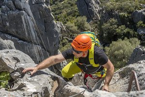 Man climbing a via ferrata