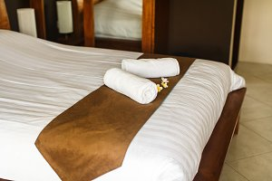 towel on the bed in room