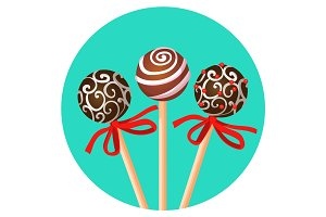 Three bonbones on stick with ornamental brown chocolate caramel