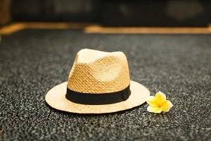 Summer straw hat with a flower