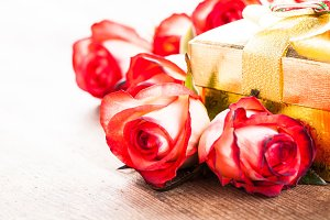 Gift box and bouquet of roses