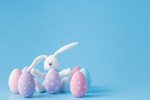 Toy rabbit with Easter eggs