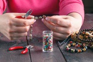 Making beads.