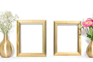 Golden picture frame and flowers