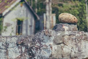Stacked Rock and Old Country House