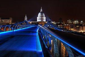blue millenium bridge at night in London