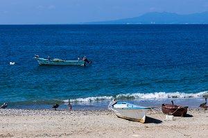 FIshing boats on sandy beach