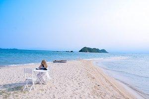 Girl enjoying sea view alone