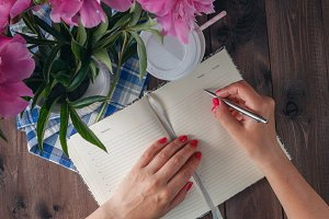 Woman write in notebook