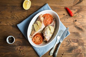Baked sea bass with tomatoes